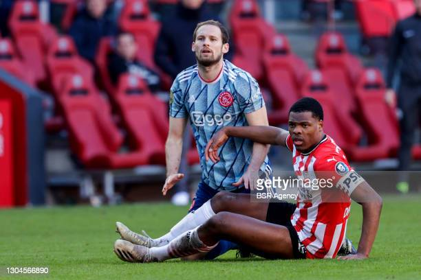 Daley Blind of Ajax and Denzel Dumfries of PSV during the Dutch Eredivisie match between PSV and Ajax at Philips Stadion on February 28, 2021 in...