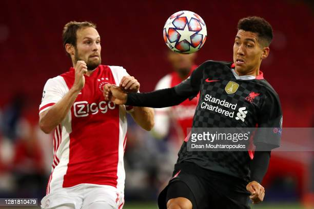 Daley Blind of Ajax battles for the ball with Roberto Firmino of Liverpool during the UEFA Champions League Group D stage match between Ajax...