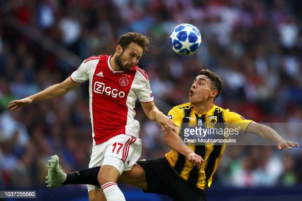 Daley Blind of Ajax battles for the ball with Viktor Klonaridis of AEK Athens during the Group E match of the UEFA Champions League between Ajax and...