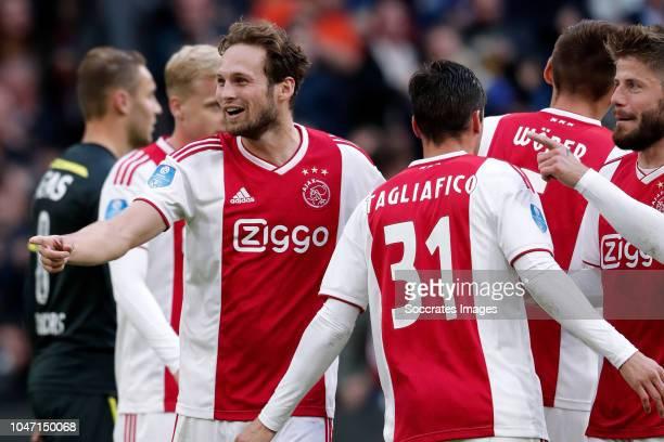 Daley Blind of Ajax celebrates 30 with Nicolas Tagliafico of Ajax Maximilian Wober of Ajax Lasse Schone of Ajax during the Dutch Eredivisie match...
