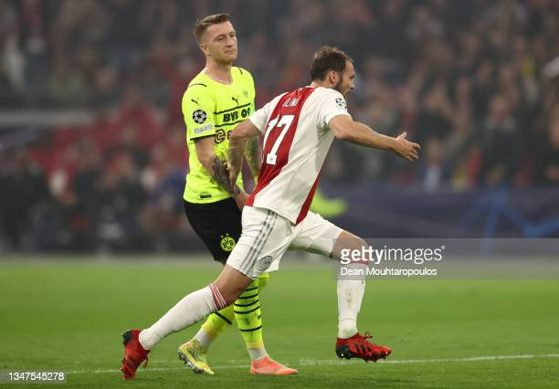 Daley Blind of Ajax celebrates after scoring their side's second goal as Marco Reus of Borussia Dortmund looks dejected during the UEFA Champions...