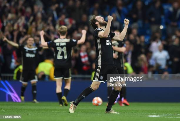 Daley Blind of Ajax celebrates victory after the UEFA Champions League Round of 16 Second Leg match between Real Madrid and Ajax at Bernabeu on March...