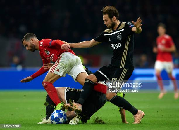 Daley Blind of Ajax competes for the ball with Rafa Silva of Benfica during the Group E match of the UEFA Champions League between Ajax and SL...