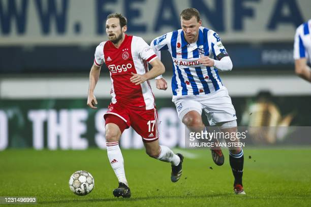 Daley Blind of Ajax fights for the ball with Henk Veerman of sc Heerenveen during the KNVB Cup semi-final match between sc Heerenveen and Ajax...
