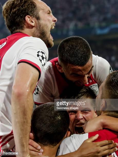 Daley Blind of Ajax, Hakim Ziyech of Ajax, Klaas Jan Huntelaar of Ajax, Dusan Tadic of Ajax, celebrate the 2-0 during the UEFA Champions League match...