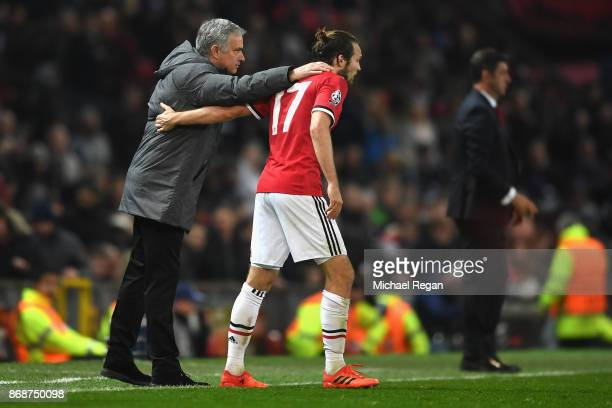 Daley Blind of Manchester United and Jose Mourinho Manager of Manchester United embrace during the UEFA Champions League group A match between...