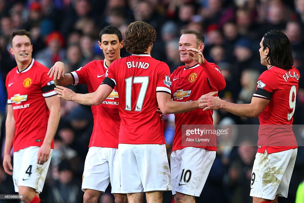 Daley Blind #17 of Manchester United and Wayne Rooney of Manchester United celebrate after their interplay led to their team's third goal during the Barclays Premier League match between Manchester United and Leicester City at Old Trafford on January 31, 2015 in Manchester, England.