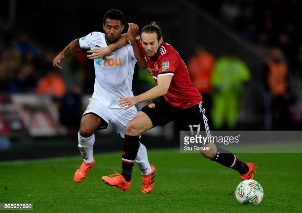 Daley Blind of Manchester United and Wayne Routledge of Swansea City during the Carabao Cup Fourth Round match between Swansea City and Manchester...