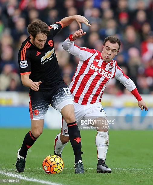 Daley Blind of Manchester United and Xherdan Shaqiri of Stoke City during the Barclays Premier League match between Stoke City and Manchester United...