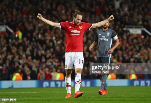 Daley Blind of Manchester United celebrates scoring a penalty his side's second goal during the UEFA Champions League group A match between...