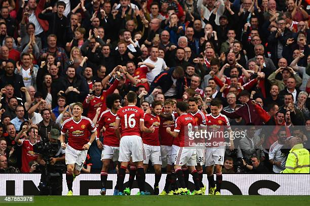 Daley Blind of Manchester United celebrates scoring the opening goal with team mates during the Barclays Premier League match between Manchester...
