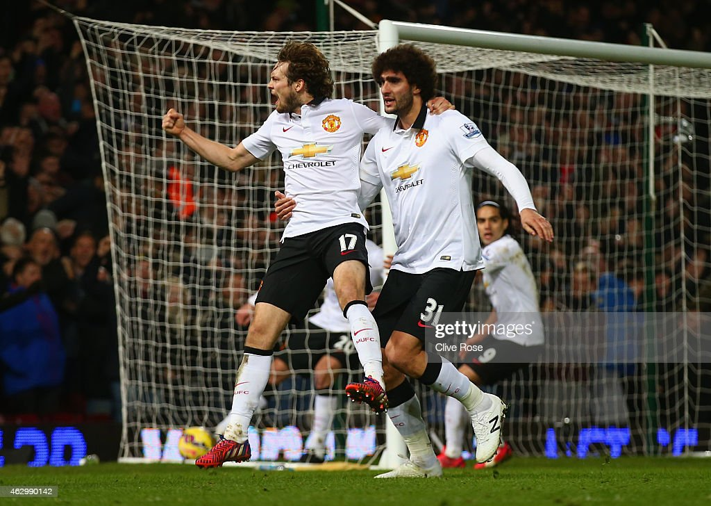 Daley Blind of Manchester United celebrates scoring their first goal with Marouane Fellaini of Manchester United during the Barclays Premier League match between West Ham United and Manchester United at Boleyn Ground on February 8, 2015 in London, England.