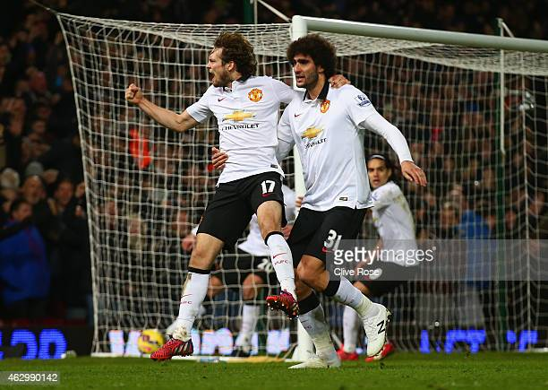 Daley Blind of Manchester United celebrates scoring their first goal with Marouane Fellaini of Manchester United during the Barclays Premier League...