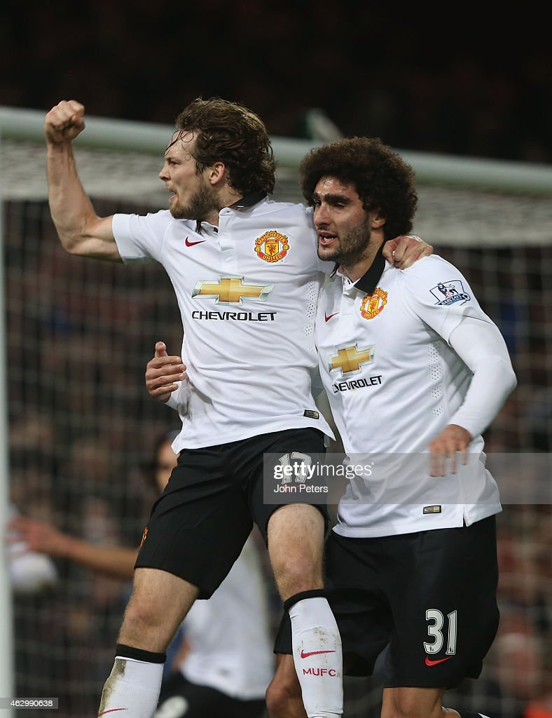 Daley Blind (L) of Manchester United celebrates scoring their first goal during the Barclays Premier League match between West Ham United and Manchester United at Boleyn Ground on February 8, 2015 in London, England.