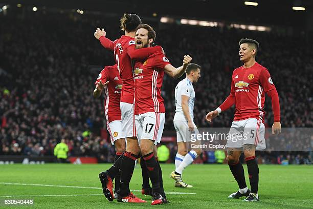 Daley Blind of Manchester United celebrates with teammate Zlatan Ibrahimovic after scoring the opening goal during the Premier League match between...