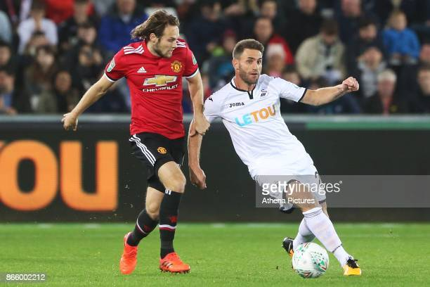 Daley Blind of Manchester United challenges Angel Rangel of Swansea City during the Carabao Cup Fourth Round match between Swansea City and...