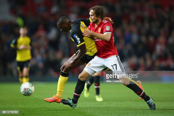 Daley Blind of Manchester United challenges Lucas Akins of Burton Albion for the ball during the Carabao Cup Third Round match between Manchester...