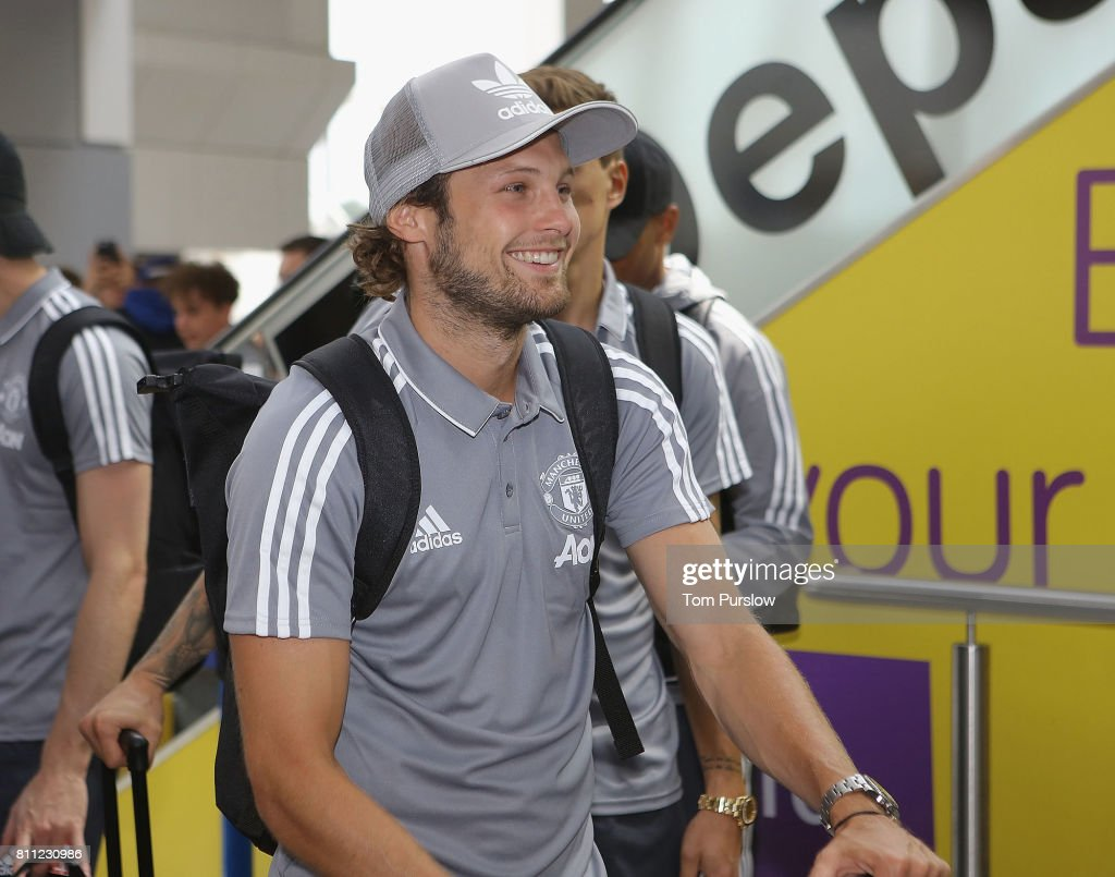 Daley Blind of Manchester United checks in at Manchester Airport ahead of the club's pre-season tour of the USA at Manchester Airport on July 9, 2017 in Manchester, England.