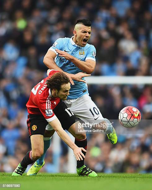 Daley Blind of Manchester United clashes with Sergio Aguero of Manchester City during the Barclays Premier League match between Manchester City and...
