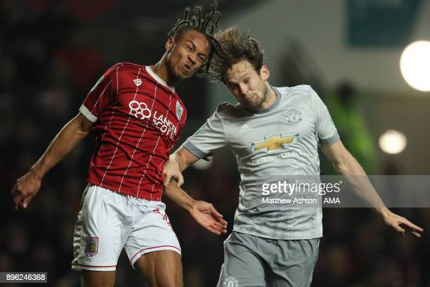 Daley Blind of Manchester United competes with Bobby Reid of Bristol City during the Carabao Cup QuarterFinal match between Bristol City and...