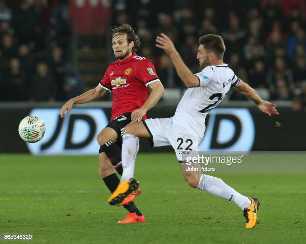 Daley Blind of Manchester United in action with Angel Rangel of Swansea City during the Carabao Cup Fourth Round match between Swansea City and...