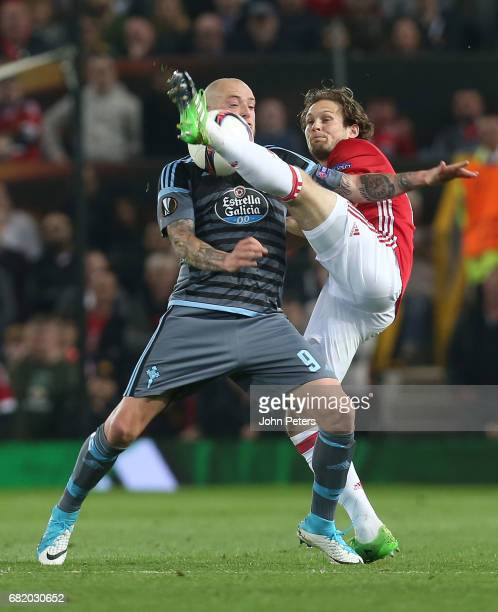 Daley Blind of Manchester United in action with John Guidetti of Celta Vigo during the UEFA Europa League semi final second leg match between...