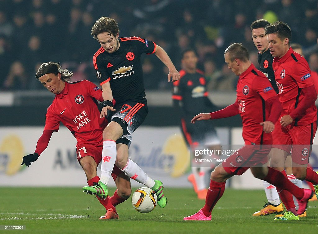 Daley Blind of Manchester United in action with Kristoffer Olsson of FC Midtjylland during the UEFA Europe League match between FC Midtjylland and Manchester United on February 18, 2016 at MCH Arena in Herning, Denmark.