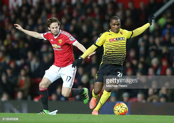 Daley Blind of Manchester United in action with Odion Ighalo of Watford during the Barclays Premier League match between Manchester United and...