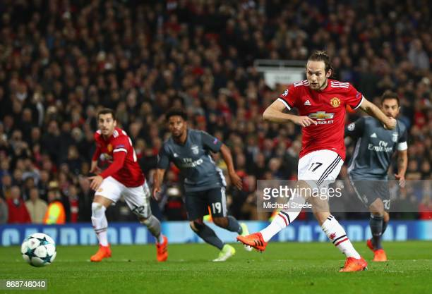 Daley Blind of Manchester United scores a penalty his side's second goal following a foul during the UEFA Champions League group A match between...