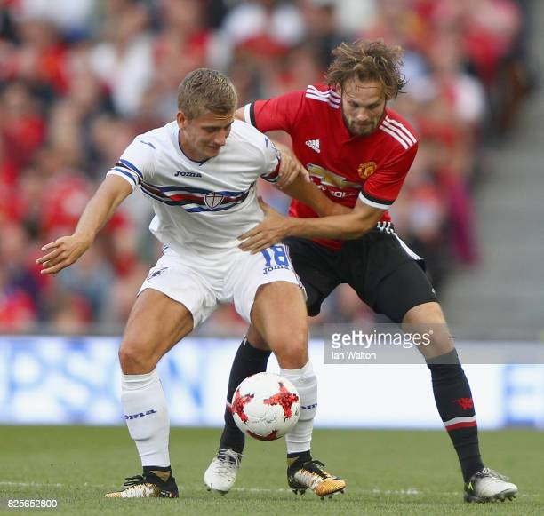 Daley Blind of Manchester United tries to tackle Dennis Praet of Sampdoria during the International Champions Cup match between Manchester United and...