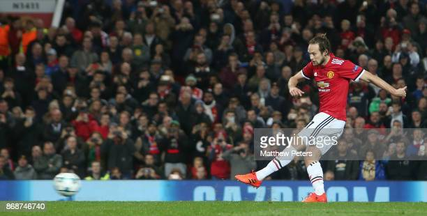 Daley Blind of Manchester Unitedscores their second goal during the UEFA Champions League group A match between Manchester United and SL Benfica at...