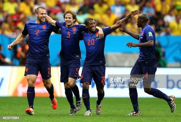 Daley Blind of the Netherlands celebrates scoring his team's second goal with his teammtes Ron Vlaar , Georginio Wijnaldum and Bruno Martins Indi...