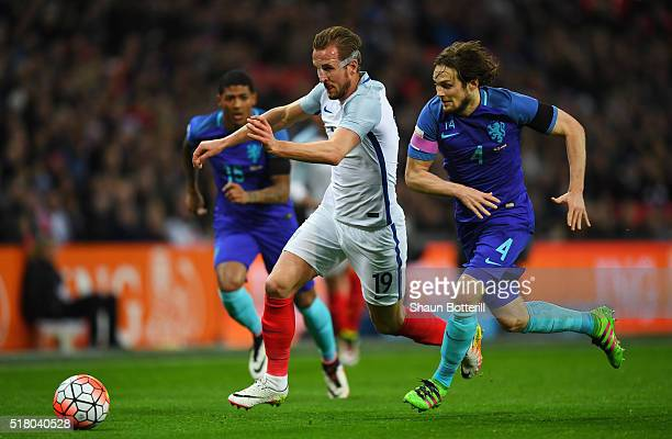 Daley Blind of the Netherlands tackles Harry Kane of England during the International Friendly match between England and Netherlands at Wembley...