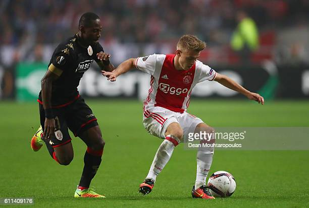 Daley Sinkgraven of Ajax is pursued by Eyong Enoh of Standard Liege during the UEFA Europa League group G match between AFC Ajax and R Standard de...