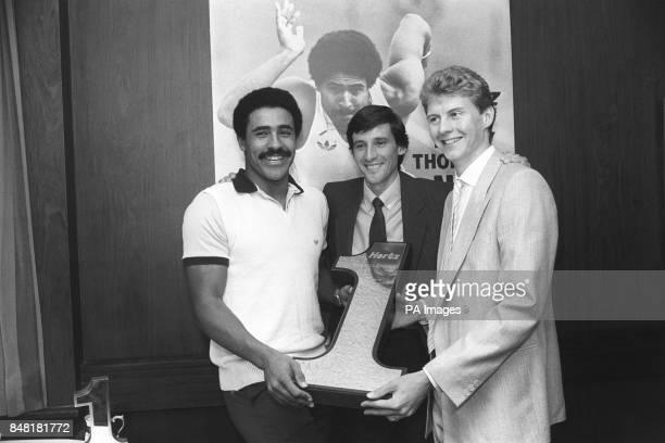 Daley Thompson, left, with Sebastian Coe, centre, and Steve Cram after being voted the Hertz No 1 Sports personality of the year. He received the...