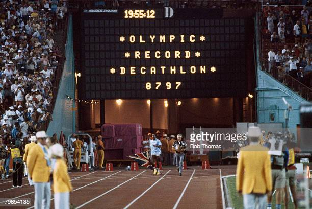 Daley Thompson of Great Britain completes a lap of honour inside the Memorial Coliseum after coming first in the Men's decathlon competition to win...