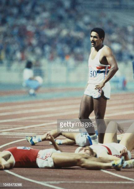 Daley Thompson of Great Britain stands in triumph above his fallen competitors after completing the 1500 metres to win the Men's Decathlon with 8743...