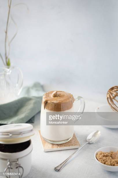 dalgona coffee, fluffy whipped coffee on milk - dalgona stock pictures, royalty-free photos & images