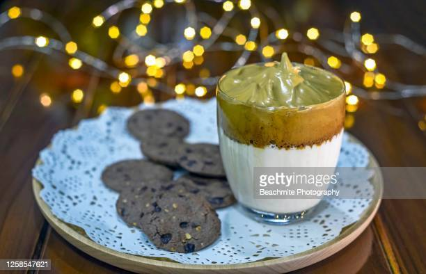 dalgona coffee in a glass and chocolate chip cookies. christmas and new year. - dalgona stock pictures, royalty-free photos & images