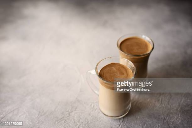 dalgona coffee in a transparent glass on a marble background - dalgona stock pictures, royalty-free photos & images