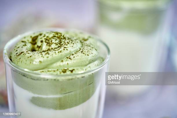 dalgona matcha latte served in a glass - dalgona stock pictures, royalty-free photos & images