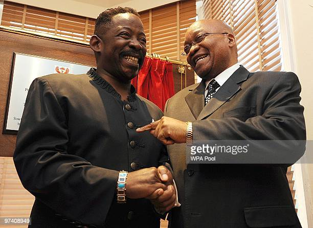 Dali Tambo son of former President of the African National Congress Oliver Tambo, shares a joke with South African President Jacob Zuma following the...