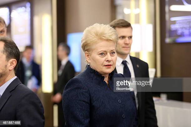 Dalia Grybauskaite, Lithuania's president, center, walks through the Kongress Zentrum, or Congress Center, during a break in sessions on the opening...