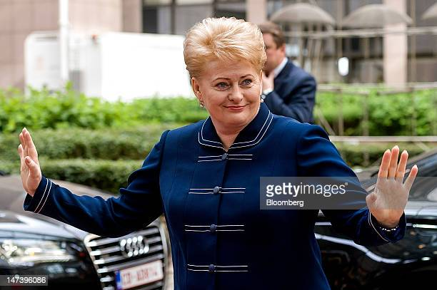 Dalia Grybauskaite, Lithuania's president, smiles and gestures as she arrives for the second day of the European Leaders summit at the European...