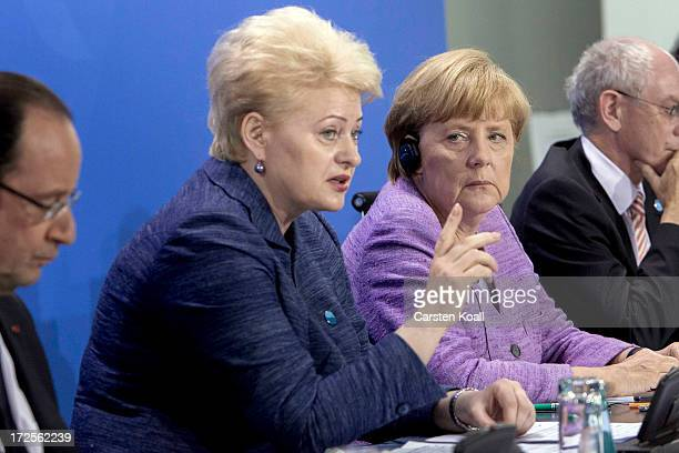 Dalia Grybauskaite President of the Republic of Lithuania and representative of the current EU Presidency and German Chancellor Angela Merkel attend...