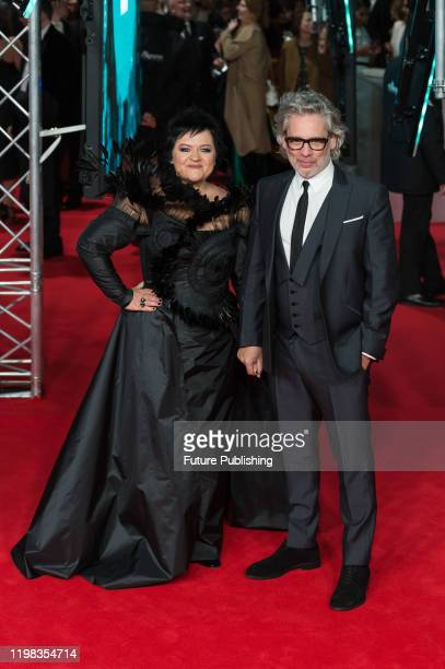 Dalia Ibelhauptaite and Dexter Fletcher attend the EE British Academy Film Awards ceremony at the Royal Albert Hall on 02 February, 2020 in London,...