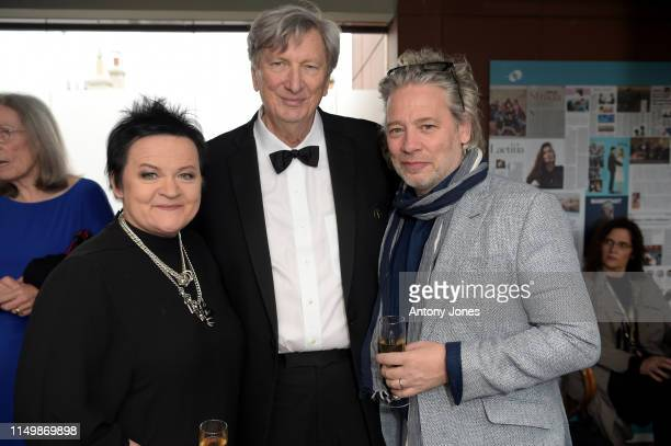Dalia Ibelhauptaite John Bailey and Dexter Fletcher attend the Academy Member Soirée at the 72nd Cannes Film Festival on May 17 2019 in Cannes France
