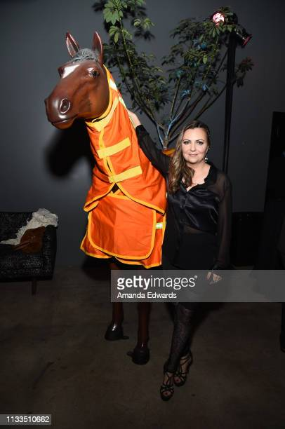 Dalia MacPhee poses with her fire resistant GPS horse blanket at The Animal Hope Wellness Foundation's 2nd Annual Compassion Gala at Playa Studios on...