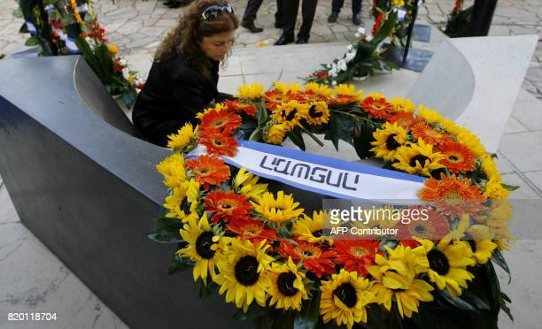 Dalia Rabin lays flowers by the grave of her father the late Israeli Prime Minister Yitzhak Rabin during a memorial ceremony in Jerusalem 02 November...