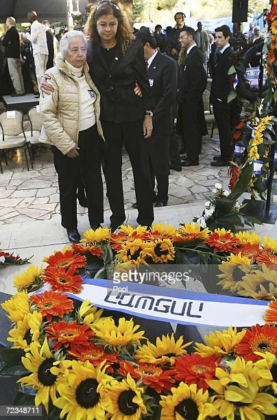 Dalia Rabin the daughter of the late Israeli prime minister Yitzhak Rabin and Rabin's sister Rahel Yaakov stand by his grave during a memorial...